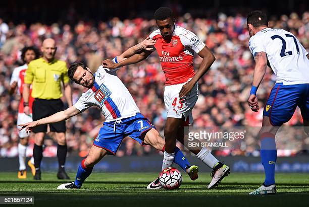 Crystal Palace's French midfielder Yohan Cabaye vies with Arsenal's Nigerian striker Alex Iwobi during the English Premier League football match...