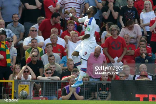Crystal Palace's Frenchborn Ghanaian striker Jordan Ayew celebrates scoring the opening goal during the English Premier League football match between...