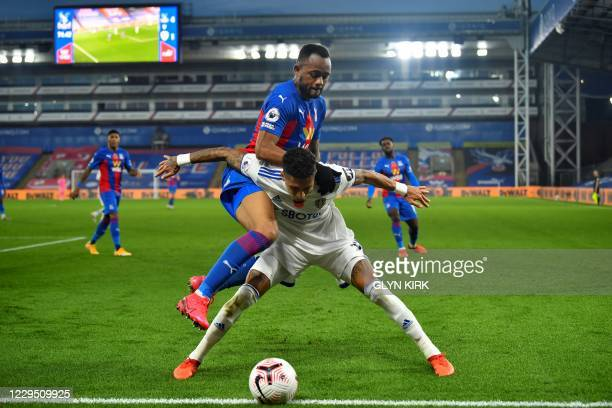 Crystal Palace's French-born Ghanaian striker Jordan Ayew fights for the ball with Leeds United's Brazilian midfielder Raphinha during the English...