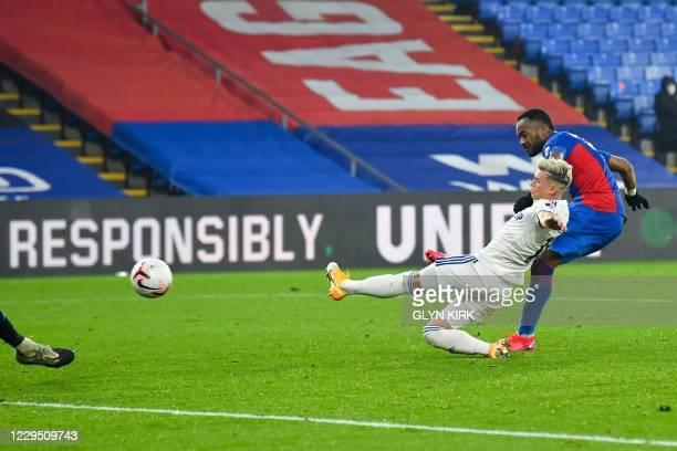 Crystal Palace's French-born Ghanaian striker Jordan Ayew scores past Leeds United's Macedonian midfielder Ezgjan Alioski during the English Premier...