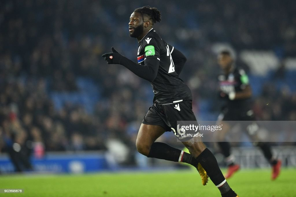Crystal Palaces French-born Malian midfielder Bakary Sako celebrates scoring his team's first goal during the English FA Cup third round football match between Brighton and Hove Albion and Crystal Palace at the American Express Community Stadium in Brighton, southern England on January 8, 2018. / AFP PHOTO / Glyn KIRK / RESTRICTED TO EDITORIAL USE. No use with unauthorized audio, video, data, fixture lists, club/league logos or 'live' services. Online in-match use limited to 75 images, no video emulation. No use in betting, games or single club/league/player publications. /