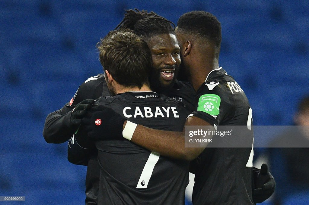 Crystal Palaces French-born Malian midfielder Bakary Sako (C) celebrates scoring his team's first goal with teammates during the English FA Cup third round football match between Brighton and Hove Albion and Crystal Palace at the American Express Community Stadium in Brighton, southern England on January 8, 2018. / AFP PHOTO / Glyn KIRK / RESTRICTED TO EDITORIAL USE. No use with unauthorized audio, video, data, fixture lists, club/league logos or 'live' services. Online in-match use limited to 75 images, no video emulation. No use in betting, games or single club/league/player publications. /