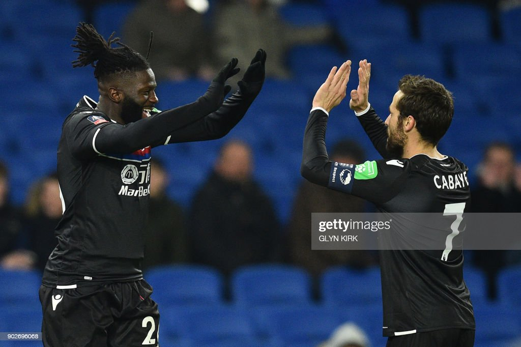 Crystal Palaces French-born Malian midfielder Bakary Sako (L) celebrates scoring his team's first goal with Crystal Palace's French midfielder Yohan Cabaye during the English FA Cup third round football match between Brighton and Hove Albion and Crystal Palace at the American Express Community Stadium in Brighton, southern England on January 8, 2018. / AFP PHOTO / Glyn KIRK / RESTRICTED TO EDITORIAL USE. No use with unauthorized audio, video, data, fixture lists, club/league logos or 'live' services. Online in-match use limited to 75 images, no video emulation. No use in betting, games or single club/league/player publications. /