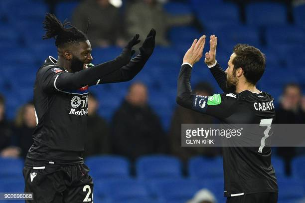 Crystal Palaces Frenchborn Malian midfielder Bakary Sako celebrates scoring his team's first goal with Crystal Palace's French midfielder Yohan...