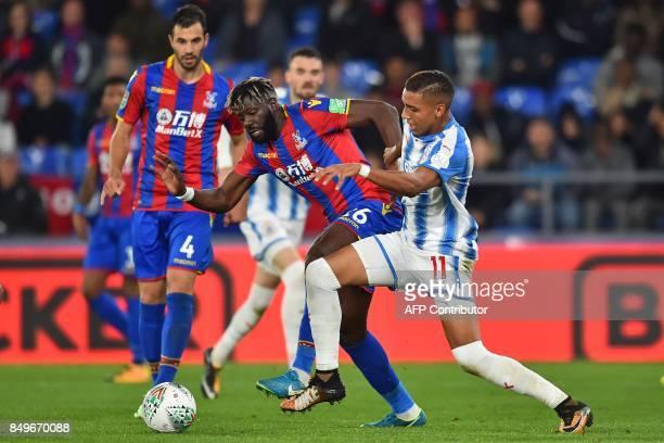 Crystal Palaces Frenchborn Malian midfielder Bakary Sako vies with Huddersfield Town's Morroccan midfielder Abdelhamid Sabiri during the English...