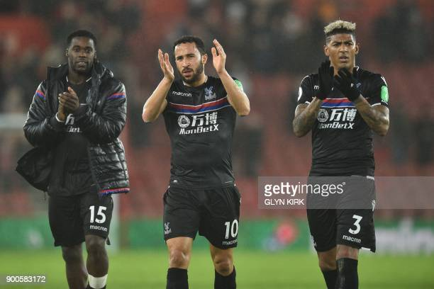 Crystal Palace's German midfielder Jeffrey Schlupp Crystal Palace's English midfielder Andros Townsend and Crystal Palace's Dutch defender Patrick...