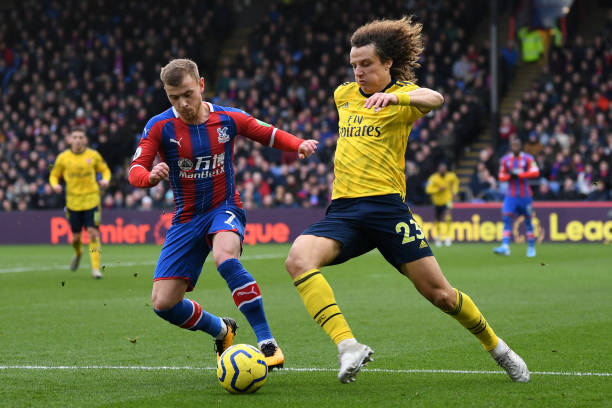 Crystal Palace's German midfielder Max Meyer vies with Arsenal's Brazilian defender David Luiz during the English Premier League football match...