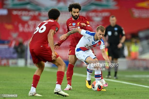 Crystal Palace's German midfielder Max Meyer vies with Liverpool's Egyptian midfielder Mohamed Salah during the English Premier League football match...