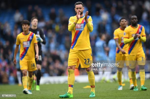 Crystal Palace's Irish defender Damien Delaney applauds the fans following the English Premier League football match between Manchester City and...