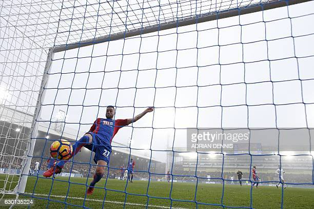 Crystal Palace's Irish defender Damien Delaney attempts to stop the ball headed by Chelsea's Brazilianborn Spanish striker Diego Costa from scoring...