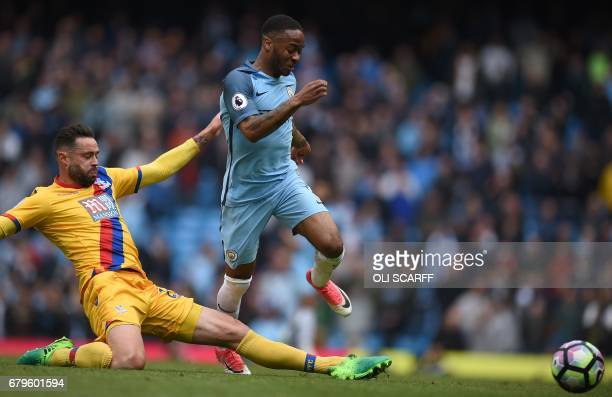 Crystal Palace's Irish defender Damien Delaney fouls Manchester City's English midfielder Raheem Sterling to concede during the English Premier...