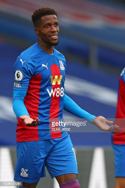 Crystal Palace's Ivorian striker Wilfried Zaha appeals during the English Premier League football match between Crystal Palace and Everton at...