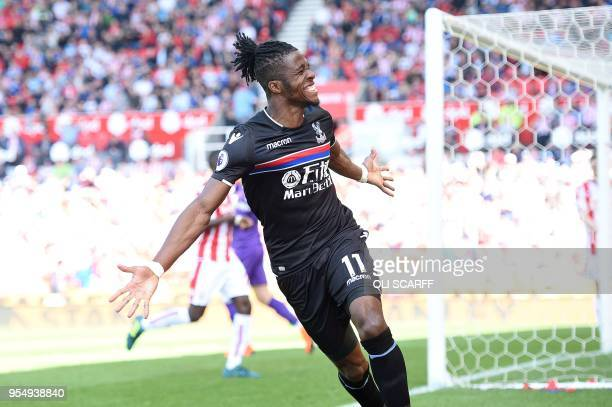 Crystal Palace's Ivorian striker Wilfried Zaha celebrates after scoring the equalising goal during the English Premier League football match between...