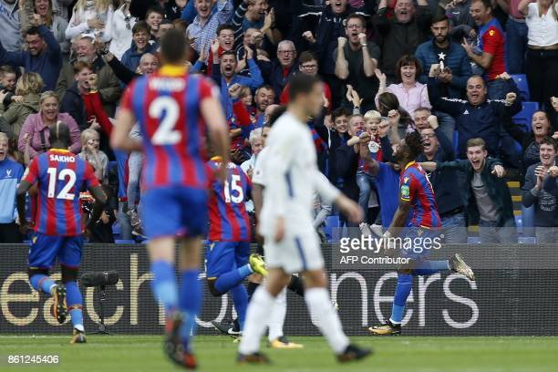 Crystal Palace's Ivorian striker Wilfried Zaha celebrates after scoring their second goal during the English Premier League football match between...