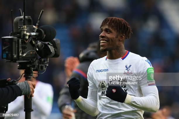 Crystal Palace's Ivorian striker Wilfried Zaha celebrates on the pitch after the English Premier League football match between Leicester City and...