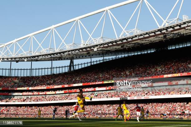 Crystal Palace's Ivorian striker Wilfried Zaha controls the ball during the English Premier League football match between Arsenal and Crystal Palace...