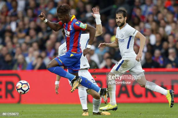 Crystal Palace's Ivorian striker Wilfried Zaha evades a challenge from Chelsea's Brazilian defender David Luiz during the English Premier League...