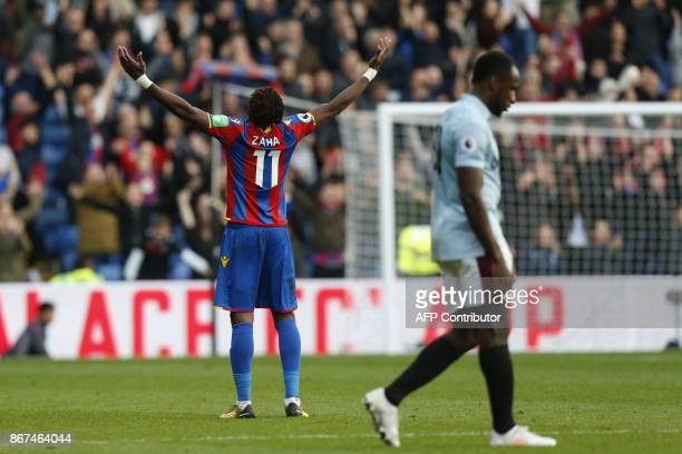 Crystal Palace's Ivorian striker Wilfried Zaha gestures at the final whistle after scoring the final goal at the English Premier League football...