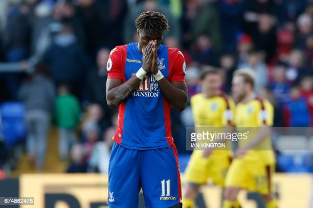 Crystal Palace's Ivorian striker Wilfried Zaha reacts after they concede their second goal during the English Premier League football match between...