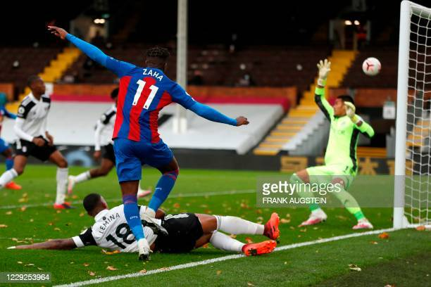 Crystal Palace's Ivorian striker Wilfried Zaha takes a shot at goal during the English Premier League football match between Fulham and Crystal...