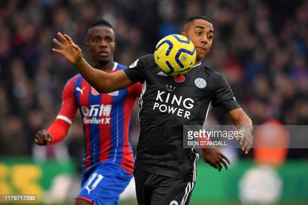 Crystal Palace's Ivorian striker Wilfried Zaha vies with Leicester City's Belgian midfielder Youri Tielemans during the English Premier League...