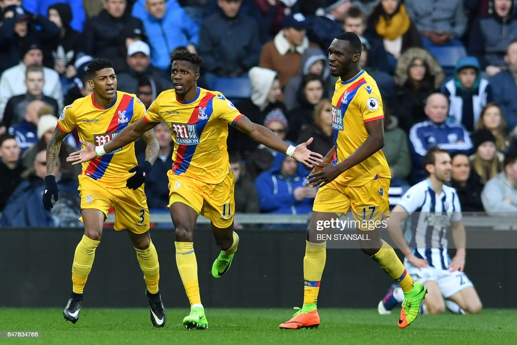 Crystal Palace's Ivorian-born English striker Wilfried Zaha (2nd L) celebrates after scoring the opening goal of the English Premier League football match between West Bromwich Albion and Crystal Palace at The Hawthorns stadium in West Bromwich, central England, on March 4, 2017. PHOTO / Ben STANSALL / RESTRICTED TO EDITORIAL USE. No use with unauthorized audio, video, data, fixture lists, club/league logos or 'live' services. Online in-match use limited to 75 images, no video emulation. No use in betting, games or single club/league/player publications. /