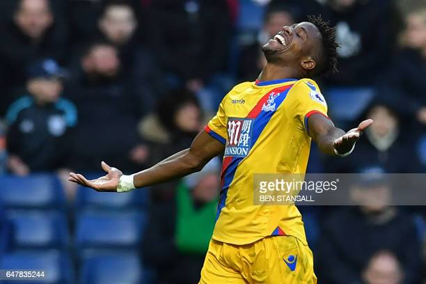 Crystal Palace's Ivorian-born English striker Wilfried Zaha celebrates after scoring the opening goal of the English Premier League football match...