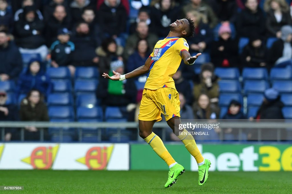 Crystal Palace's Ivorian-born English striker Wilfried Zaha celebrates after scoring the opening goal of the English Premier League football match between West Bromwich Albion and Crystal Palace at The Hawthorns stadium in West Bromwich, central England, on March 4, 2017. PHOTO / Ben STANSALL / RESTRICTED TO EDITORIAL USE. No use with unauthorized audio, video, data, fixture lists, club/league logos or 'live' services. Online in-match use limited to 75 images, no video emulation. No use in betting, games or single club/league/player publications. /