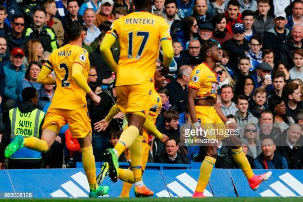 Crystal Palace's Ivorianborn English striker Wilfried Zaha celebrates after scoring their first goal during the English Premier League football match...
