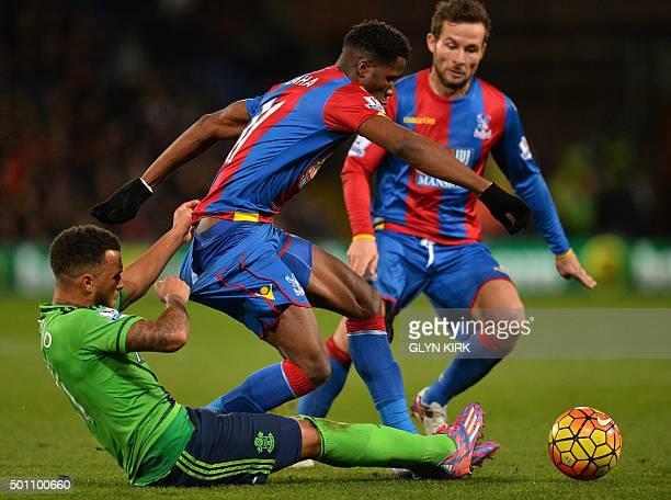 Crystal Palace's Ivorianborn English striker Wilfried Zaha vies with Southampton's English defender Ryan Bertrand during the English Premier League...