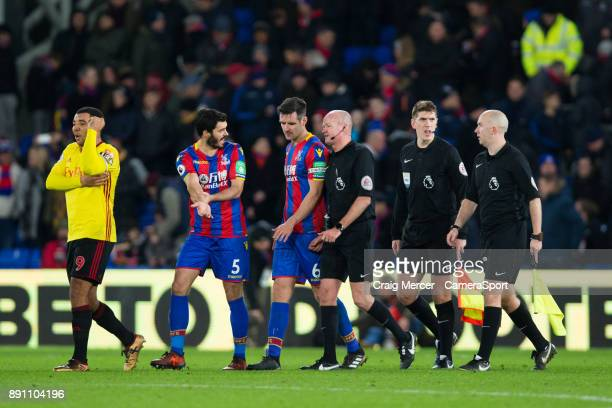 Crystal Palace's James Tomkins appears to claim a handball in discussions with Referee Lee Mason during the Premier League match between Crystal...