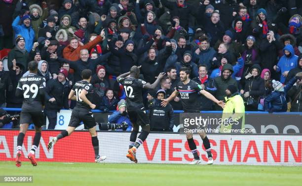 Crystal Palace's James Tomkins celebrates scoring the opening goal with teammate Mamadou Sakho during the Premier League match between Huddersfield...