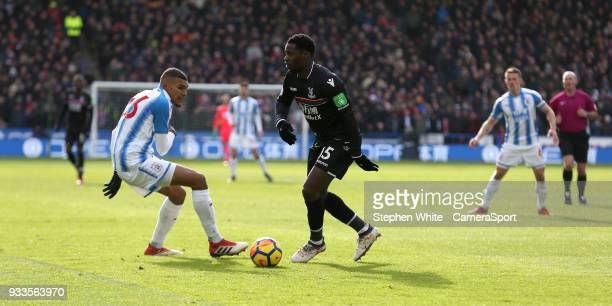 Crystal Palace's Jeffrey Schlupp and Huddersfield Town's Collin Quaner during the Premier League match between Huddersfield Town and Crystal Palace...