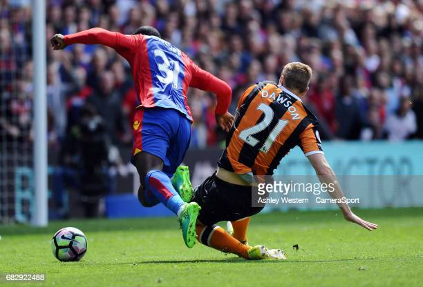 Crystal Palace's Jeffrey Schlupp is fouled by Hull City's Michael Dawson leading to a penalty during the Premier League match between Crystal Palace...