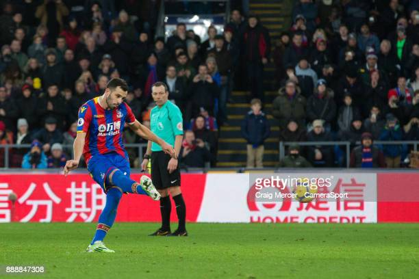 Crystal Palace's Luka Milivojevic scores his side's equalising goal from the penalty spot to make the score 11 during the Premier League match...