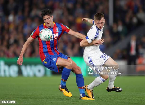 Crystal Palace's Martin Kelly and Ipswich Town's Ben Morris battle for the ball during the Carabao Cup Second Round match at Selhurst Park London