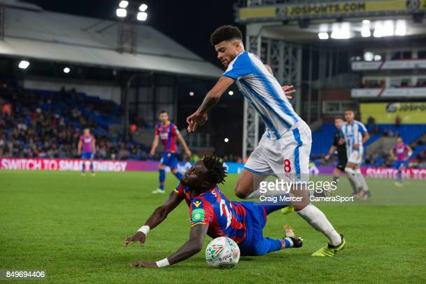 Crystal Palace's Pape N'Diaye Souare is fouled by Huddersfield Town's Philip Billing during the Carabao Cup Third Round match between Crystal Palace...