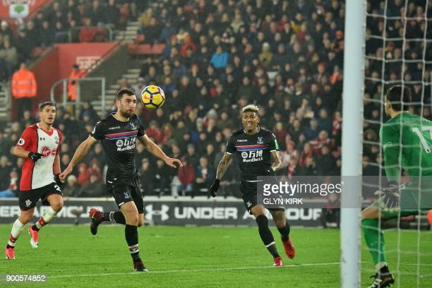 Crystal Palace's Scottish midfielder James McArthur controls the ball on his way to scoring their first goal during the English Premier League...
