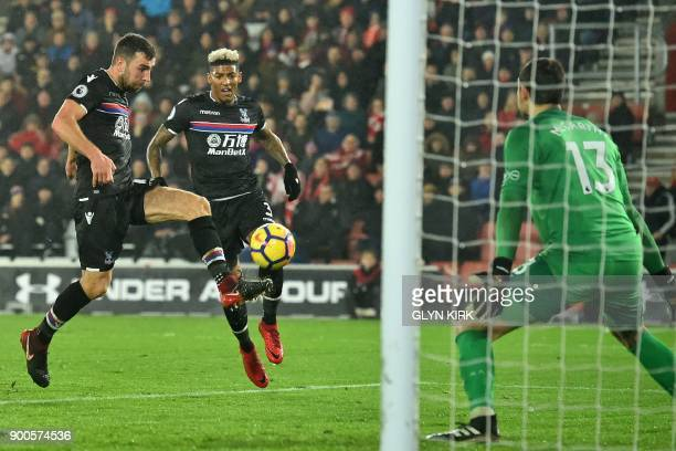 Crystal Palace's Scottish midfielder James McArthur shoots to score their first goal past Southampton's English goalkeeper Alex McCarthy during the...