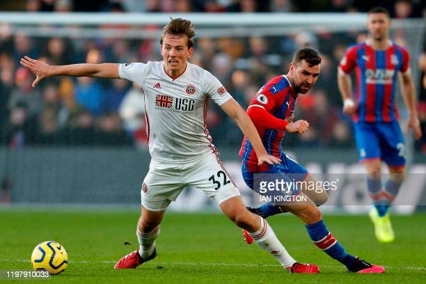 Crystal Palace's Scottish midfielder James McArthur vies with Sheffield United's Norwegian midfielder Sander Berge during the English Premier League...