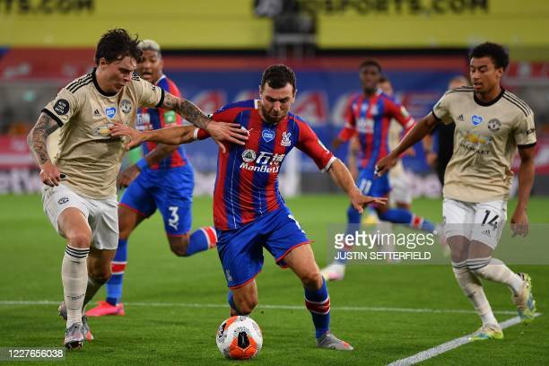 Crystal Palace's Scottish midfielder James McArthur vies with Manchester United's Swedish defender Victor Lindelof and Manchester United's English...