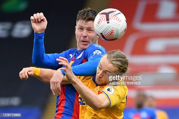 Crystal Palace's Scottishborn Irish midfielder James McCarthy vies with Everton's English midfielder Tom Davies during the English Premier League...