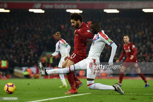 Crystal Palace's Senegalese midfielder Cheikhou Kouyate vies with Liverpool's Egyptian midfielder Mohamed Salah during the English Premier League...