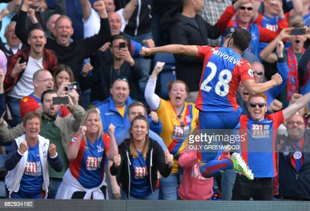Crystal Palace's Serbian midfielder Luka Milivojevic celebrates scoring a goal off a penalty during the English Premier League football match between...