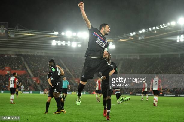 Crystal Palace's Serbian midfielder Luka Milivojevic celebrates after scoring their second goal during the English Premier League football match...