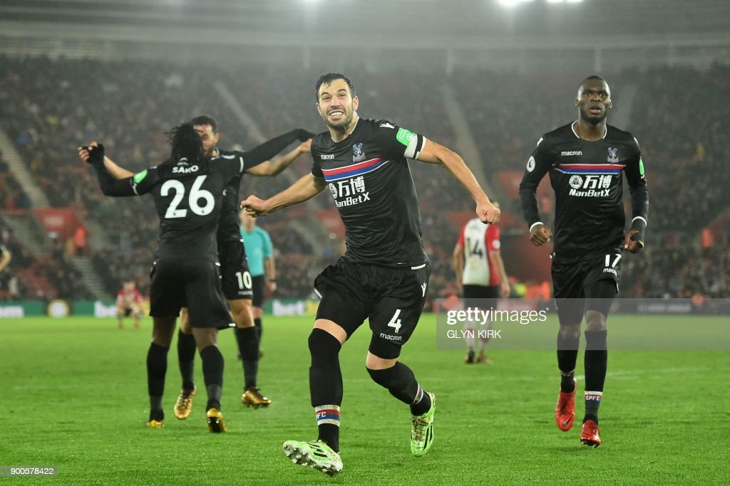Crystal Palace's Serbian midfielder Luka Milivojevic (C) celebrates after scoring their second goal during the English Premier League football match between Southampton and Crystal Palace at St Mary's Stadium in Southampton, southern England on January 2, 2018. / AFP PHOTO / Glyn KIRK / RESTRICTED TO EDITORIAL USE. No use with unauthorized audio, video, data, fixture lists, club/league logos or 'live' services. Online in-match use limited to 75 images, no video emulation. No use in betting, games or single club/league/player publications. /
