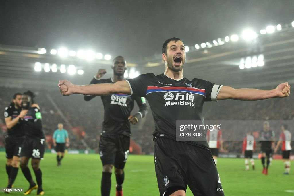 Crystal Palace's Serbian midfielder Luka Milivojevic (R) celebrates after scoring their second goal during the English Premier League football match between Southampton and Crystal Palace at St Mary's Stadium in Southampton, southern England on January 2, 2018. / AFP PHOTO / Glyn KIRK / RESTRICTED TO EDITORIAL USE. No use with unauthorized audio, video, data, fixture lists, club/league logos or 'live' services. Online in-match use limited to 75 images, no video emulation. No use in betting, games or single club/league/player publications. /