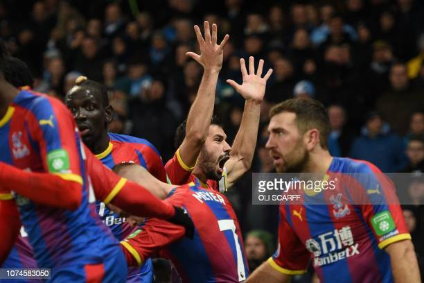 Crystal Palace's Serbian midfielder Luka Milivojevic celebrates scoring their third goal from the penalty spot to extend their lead 13 during the...