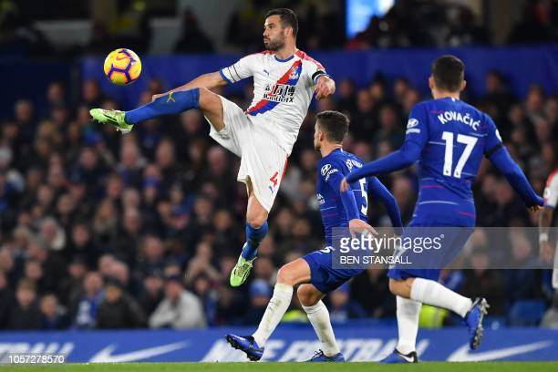 TOPSHOT Crystal Palace's Serbian midfielder Luka Milivojevic jumps to control the ball during the English Premier League football match between...