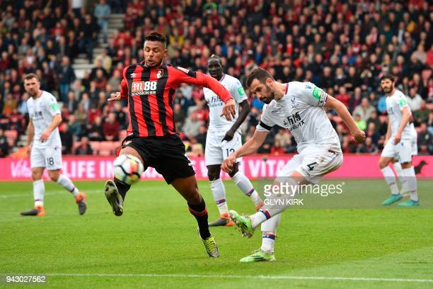 Crystal Palace's Serbian midfielder Luka Milivojevic plays the ball as Crystal Palace's Swedish midfielder Erdal Rakip tries to block during the...